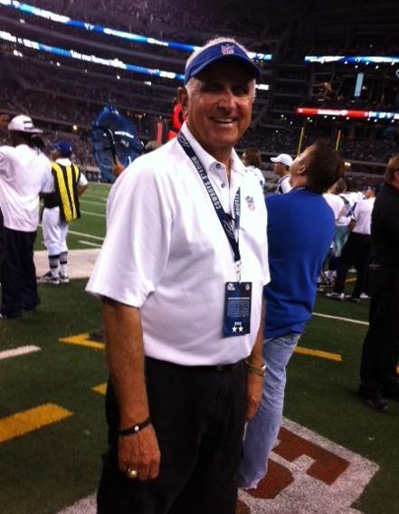 Norm Burgess, lead technologist, on field with the Dallas Cowboys, 2011